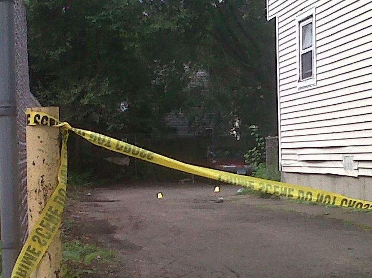 Police investigate shooting. William Kaempffer/Register