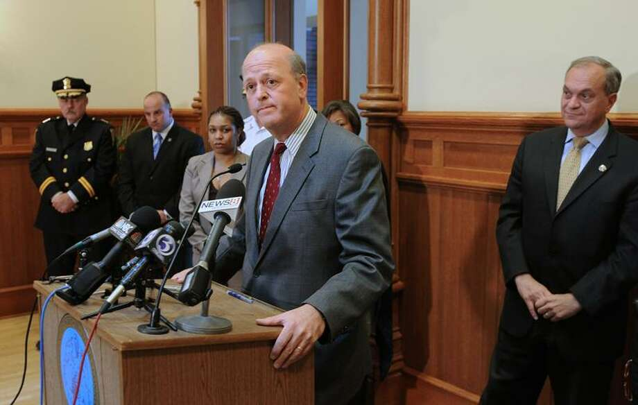 New Police Chief Dean Esserman, center, answers questions after Mayor John DeStefano Jr., right, announced Esserman will replace current Chief Frank Limon during a press conference Tuesday at New Haven City Hall. Peter Casolino/Register