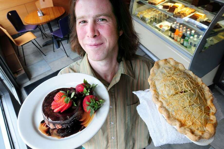 Arnold Gold/Register photo: Ben Gaffney of Atticus Bookstore Cafe in New Haven was happy to share recipes for Chocolate Bread Pudding and Chicken Potpie.