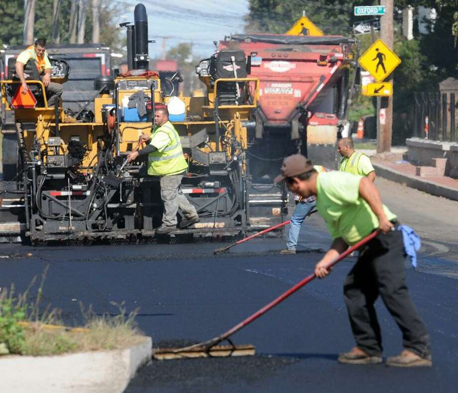 Crews from Empire Paving pave Quinnipiac Avenue in New Haven as part of a reconstruction project in this file photo.