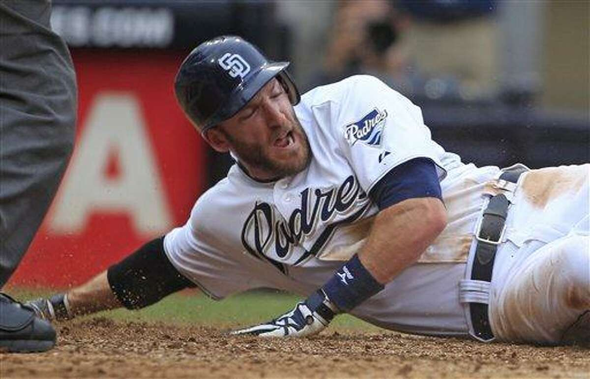 San Diego Padres' Chris Denorfia reacts after being tagged out while trying to score in the eighth inning of the Padres 5-3 loss to the Colorado Rockies in a baseball game on Wednesday, June 8, 2011, in San Diego. (AP Photo/Lenny Ignelzi)