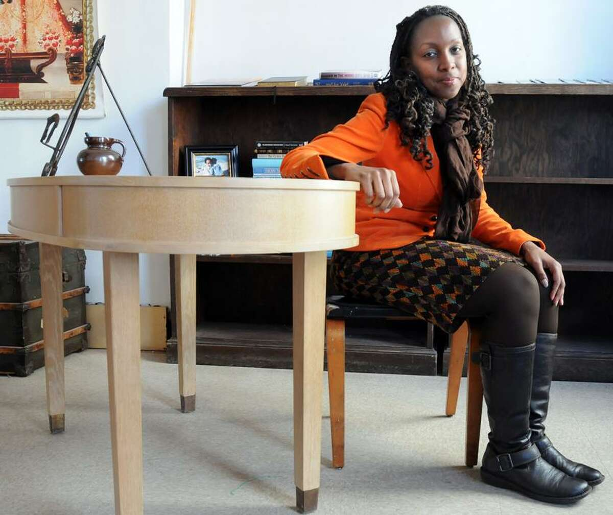 Mara Lavitt/Register photo: Thanks to Project Storefronts, networker extraordinaire Eraina Davis set up her consulting business, The Good Life, in downtown New Haven in the Goldie & Libro building.
