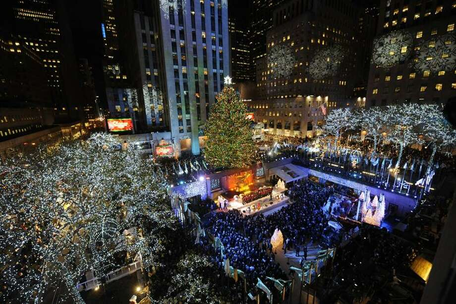 Henny Ray Abrams/Associated Press photo: This columnist loves to visit the Rockefeller Center Christmas Tree in New York City. This year's 74-foot-tall tree is lit by 30,000 energy-efficient LED lights Photo: AP / AP2011