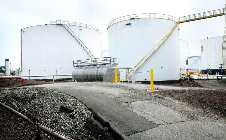 Storage tanks are seen at the New Haven Harbor terminal Friday in New Haven. State officials traced contaminated gasoline to a fuel storage tank at the terminal. Arnold Gold/Register