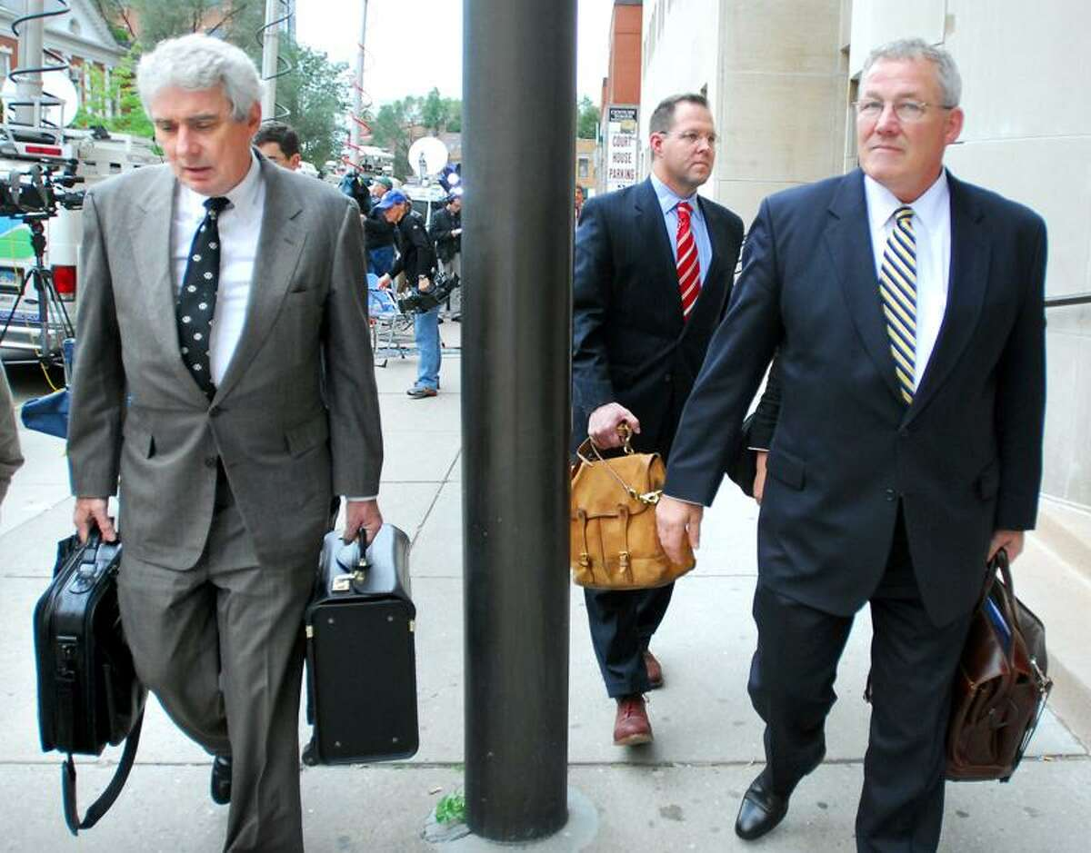Left to right, Joshua Komisarjevsky's attorneys Jeremiah Donovan, Todd Bussert and Walter Bansley III walk out of Superior Court in New Haven after guilty verdicts were announced for their client on 10/13/2011.Photo by Arnold Gold/New Haven Register AG0427B