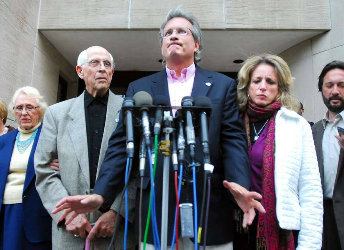 Left to right, Marybelle Hawke, Rev. Richard Hawke, Dr. William Petit, Jr., and his sister Johanna Petit Chapman meet the press following the guilty verdicts for Joshua Komisarjevsky in front of Superior Court in New Haven on 10/13/2011.Photo by Arnold Gold/New Haven Register AG0427B