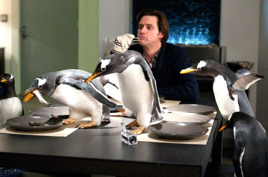 """Barry Wetcher/20th Century Fox photo: Jim Carrey stars in """"Mr. Popper's Penguins."""" Photo: AP / TM and © 2011 Twentieth Century Fox Film Corporation.  All rights reserved.  Not for sale or duplication."""