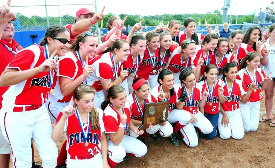 Foran softball players celebrate their win over Bacon Academy in the Class L state final Monday. Foran finished No. 1 in the Register Top 10 poll for the first time in school history. Photo by Arnold Gold/New Haven Register