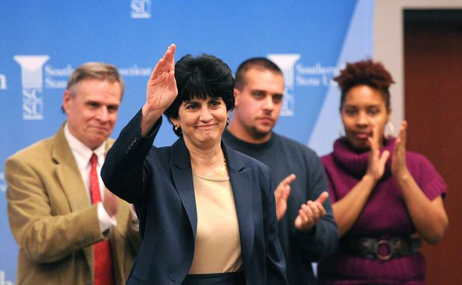 Mary Papazian the new president of Southern Connecticut State University, waves to faculty and students during an introduction ceremony Thursday.   Peter Casolino/Register