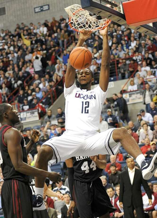 Connecticut's Andre Drummond dunks in fron of Harvard's Keith Wright (44) during the first half of an NCAA college basketball game in Storrs, Conn., Thursday, Dec. 8, 2011. (AP Photo/Bob Child) Photo: AP / FR 170410  AP