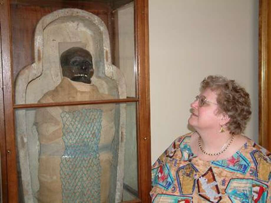 Submitted Photo S.J. Wolfe with Padihershef, the first Egyptian mummy to be commercially displayed in the United States.