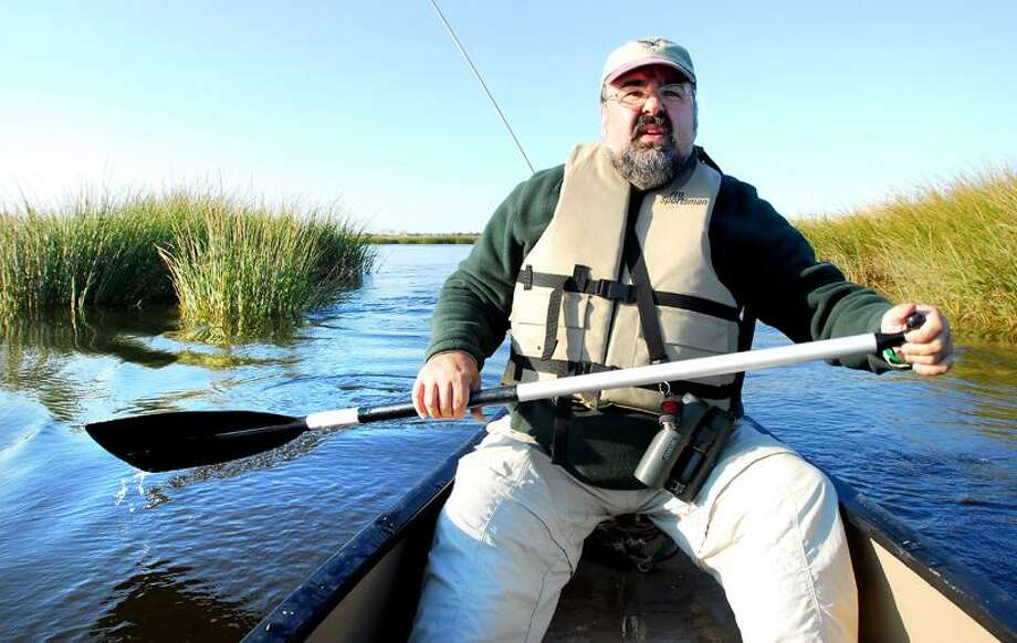Arnold Gold/Register photo: Frank Gallo, director of the Connecticut Audubon Society Coastal Center at Milford Point, paddles through the Charles E. Wheeler Salt Marsh on a recent fall afternoon.