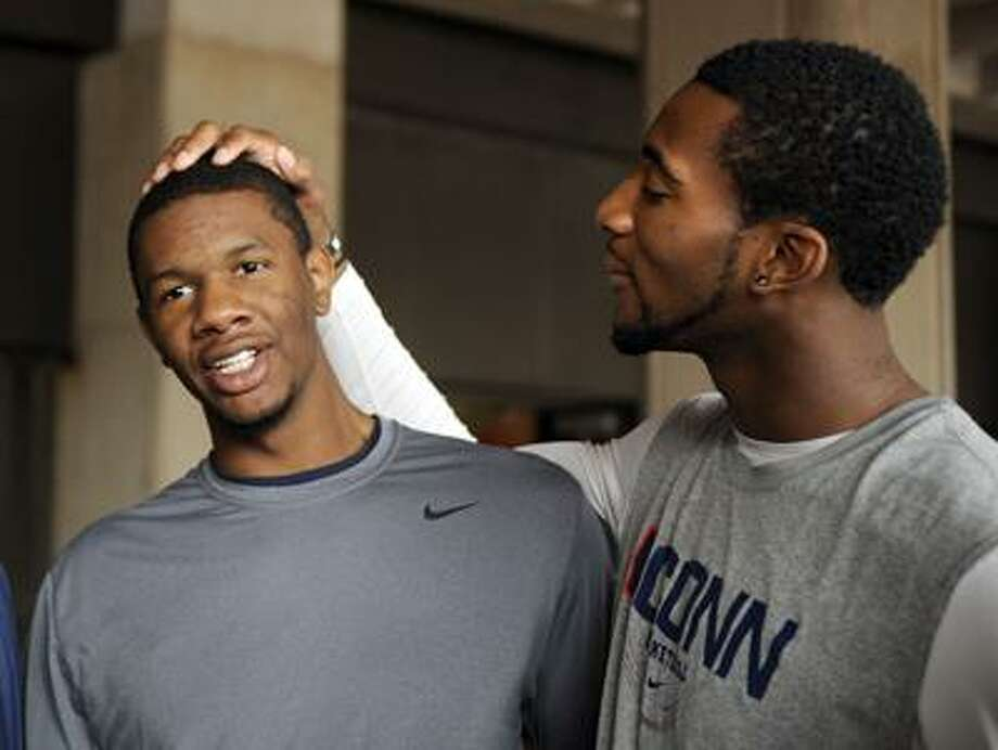 Michael Bradley, left, and Andre Drummond share a moment before the Connecticut men's basketball team's Husky Run in Storrs, Conn., on Wednesday, Oct. 12, 2011. (AP Photo/Fred Beckham) Photo: AP / FR153656 AP