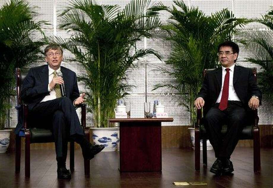 Microsoft Corp. co-founder Bill Gates, left, speaks to the media while China's Vice Minister of Science and Technology Zhang Laiwu, right, listens after Gates delivered a speech at the Ministry of Science and Technology in Beijing Wednesday. Associated Press Photo: AP / AP
