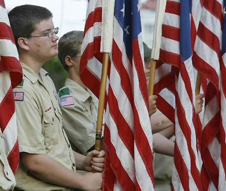 Dispatch Staff Photo by JOHN HAEGERMichael Fedroff, 15, of Troop 23 and other Boy Scout Troop 23 members, hold different American flags from United States history during the annual Oneida Elks Lodge #767 Flag Day program on Tuesday, June 14, 2011 in Oneida.