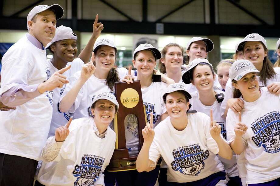 Submitted Photo by TIM FULLER VVS alum Molly Kane, at left in the front row, poses with her Amherst College women's basketball team after winning the NCAA Division III title in March. Kane was the assistant coach. Photo: Tim Fuller / Tim Fuller