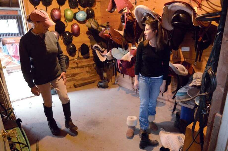 Walter-Robinson and Misur go over a few wardrobe and equipment options in the tack room before they head out to the paddock.