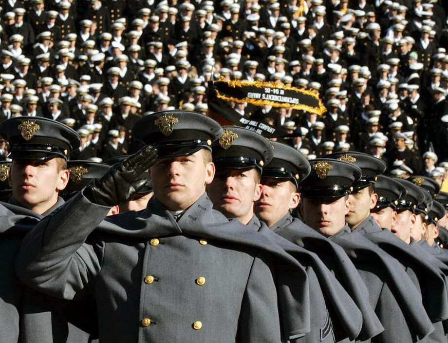 Army cadets march onto the field beffore the start of the Army-Navy football game Saturday, Dec. 3, 2005, in Philadelphia. (AP Photo/Rusty Kennedy) Photo: ASSOCIATED PRESS / AP2005