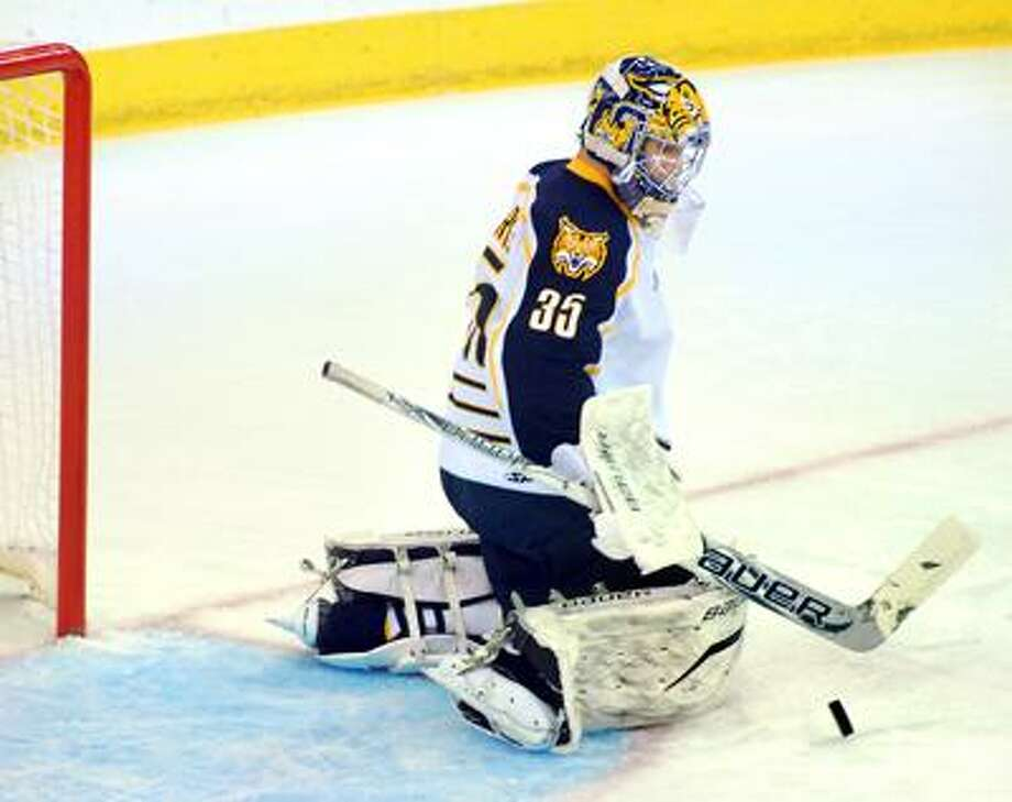 Quinnipiac goalie Dan Clarke deflects the puck in the first period against Holy Cross on 10/12/2011.Photo by Arnold Gold/New Haven Register     AG0427A