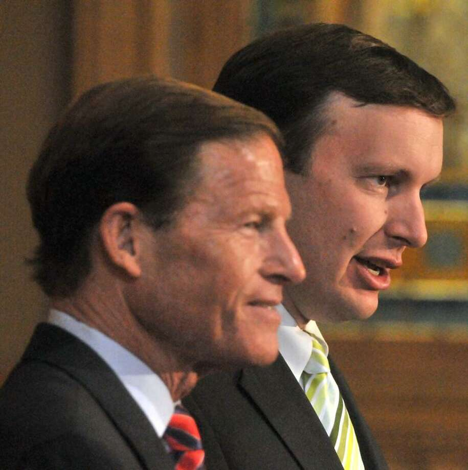 U.S. Sen. Richard Blumenthal, D-Conn., and U.S. Rep. Christopher Murphy, D-5, speak Monday at the state Capitol building about the debt crisis, the state budget and manufacturing in Connecticut. Brad Horrigan/Register