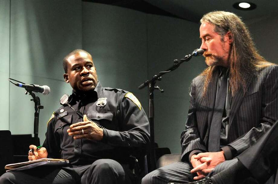 New Haven police Officer Shafiq Abdussabur, left, responds to a point made by author David Kennedy at an antiviolence forum Wednesday at Co-operative Arts and Humanities Interdistrict High School in New Haven. VM Williams/Register
