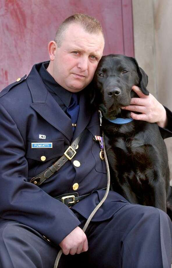 New Haven Police Officer Robert Fumiatti and his drug dog, Major, after their graduation from the State Police Canine Training Unit in Meriden. Mara Lavitt/Register file photo