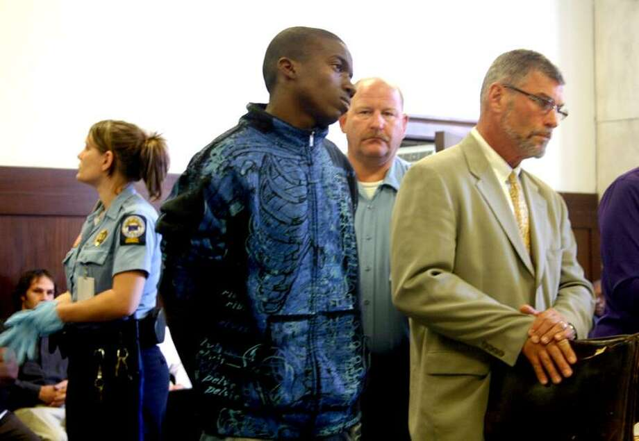 Kmel Davis is arraigned in the shooting death of Melvin Galloway, Tuesday in Superior Court. William Kaempffer/ Register