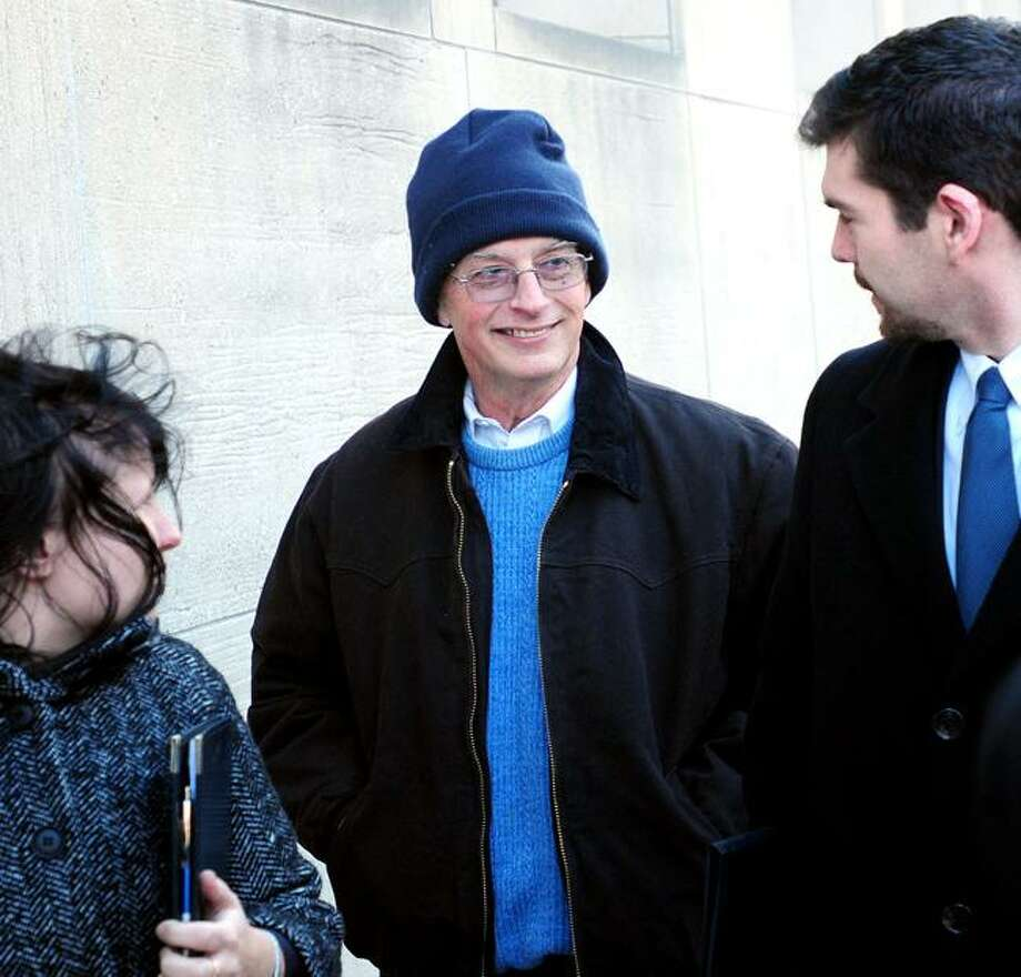 Joshua Komisarjevsky's father, Benjamin Komisarjevsky (center), walks out of Superior Court in New Haven during lunch recess following a ruling that Judge Jon Blue will preside over the trial of his son in the Cheshire home invasion on 2/15/2011. Photo by Arnold Gold/New Haven Register