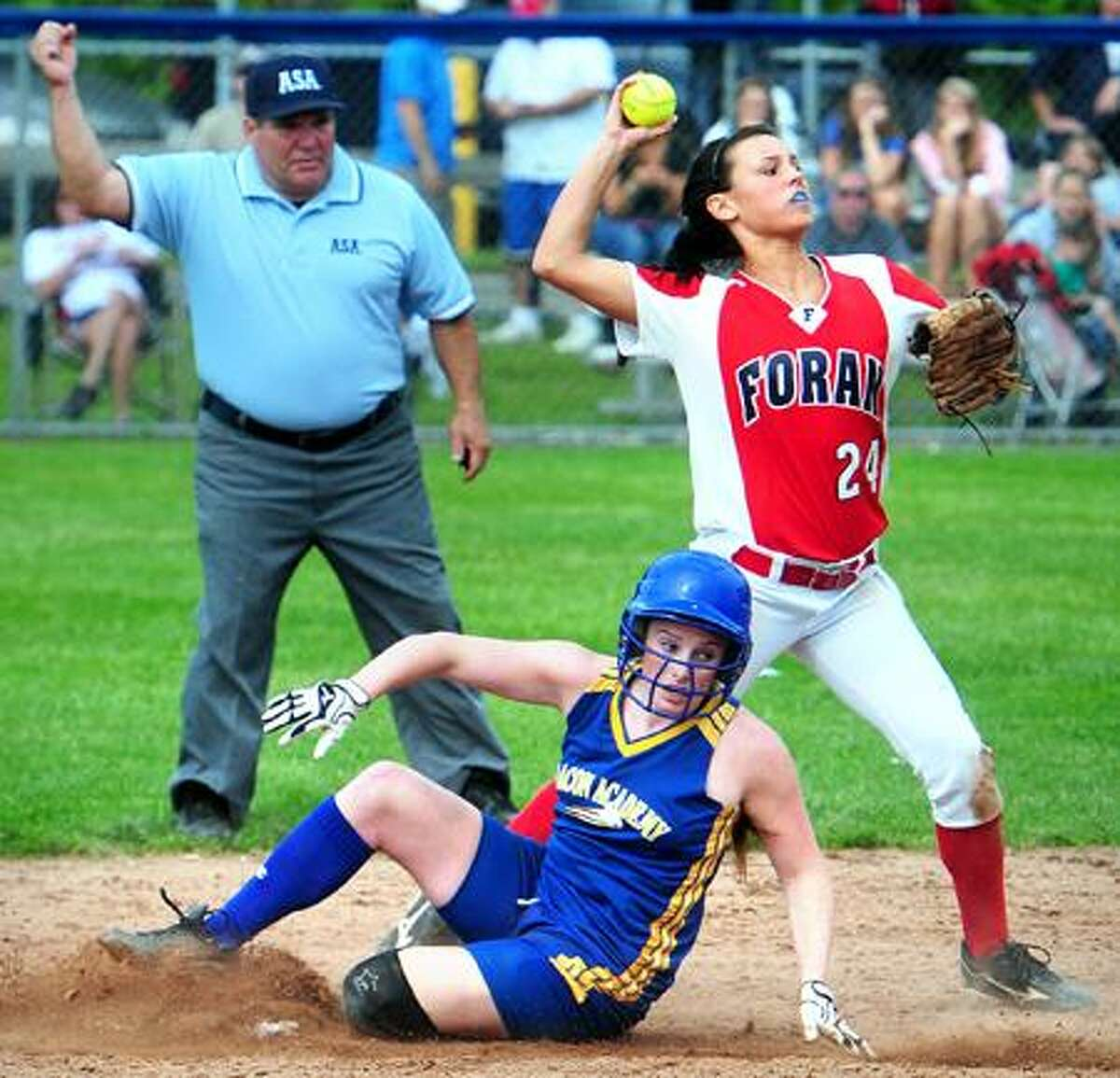 Kelsey McCarthy (bottom) of Bacon Academy is forced out at second base as Brooke Phelan (right) of Foran throws to complete the double play to win the Class L State Softball final at West Haven High School on 6/13/2011.Photo by Arnold Gold/New Haven Register AG0414D
