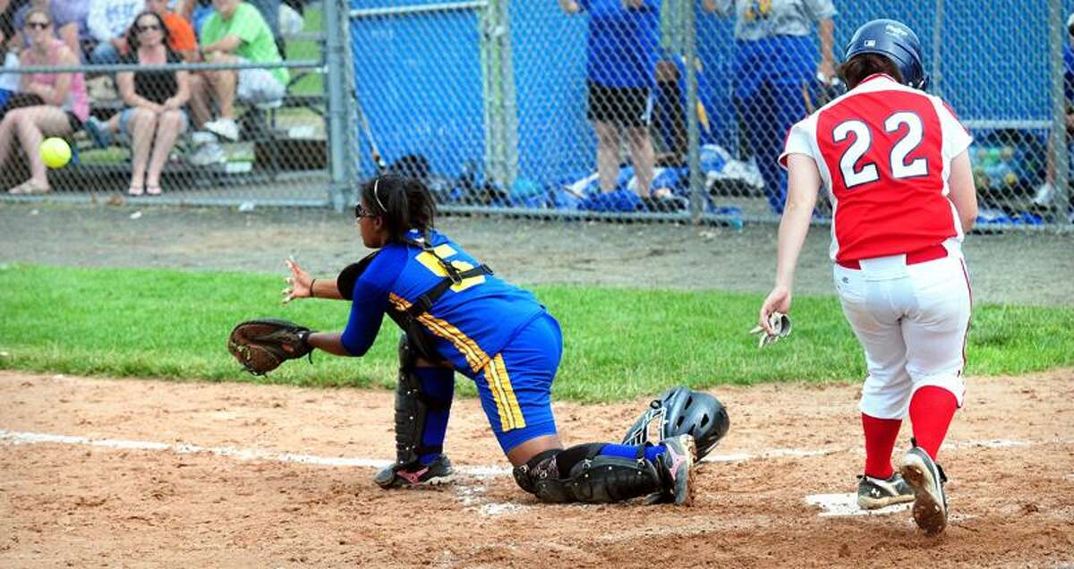 Catcher Alicia White (center) of Bacon Academy gets the ball late as Rachel Booth (right) of Foran scores in the Class L State Softball final at West Haven High School on 6/13/2011.Photo by Arnold Gold/New Haven Register AG0414D