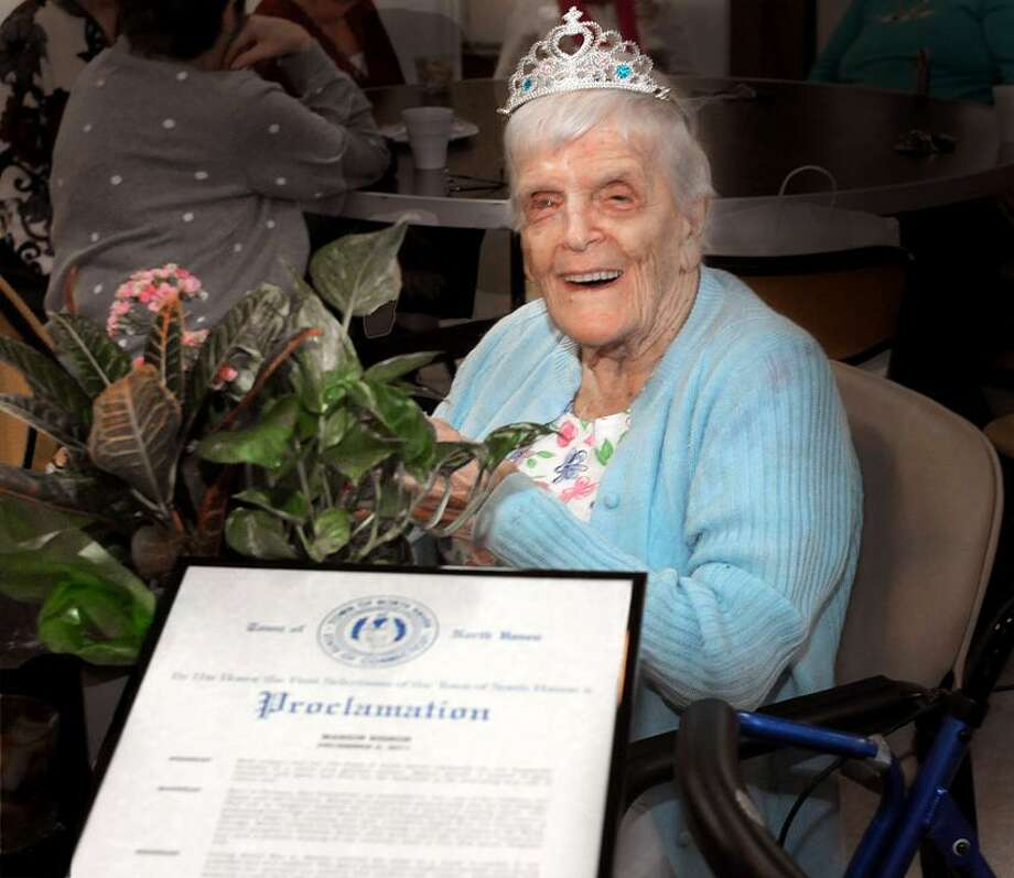 Former World War II nurse Marion Eisner at her birthday celebration. She was given a proclamation by North Haven First Selectman Michael Freda. Melanie Stengel/Register