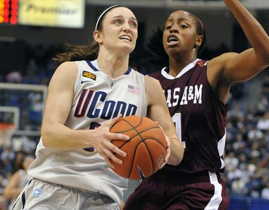 Connecticut's Kelly Faris, left, drives to the basket while guarded by Texas A&M's Adaora Elonu, right, in the first half of an NCAA college basketball game in Hartford, Conn., Tuesday, Dec. 6, 2011.   (AP Photo/Jessica Hill) Photo: AP / AP2011