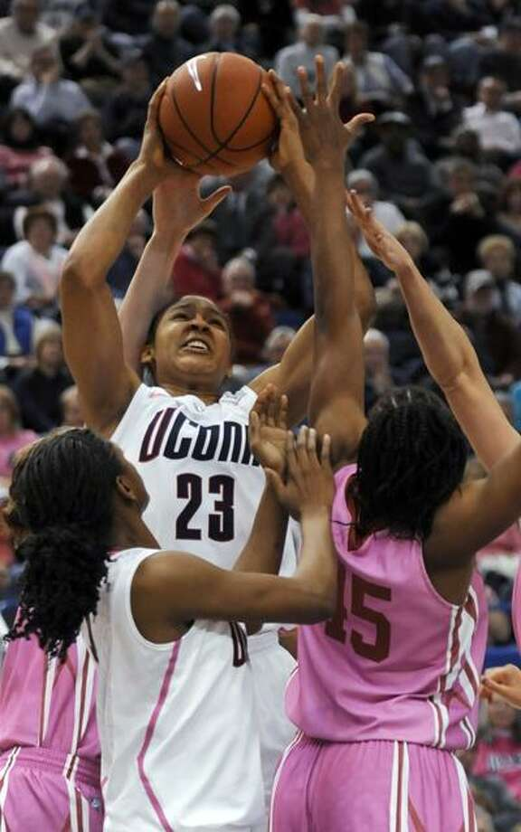 Connecticut's Maya Moore takes aim at the basket in the second half against Oklahoma in an NCAA college basketball game in Hartford, Conn., Monday, Feb. 14, 2011. Connecticut won 86-45. (AP Photo/Bob Child) Photo: AP / FRE 170410
