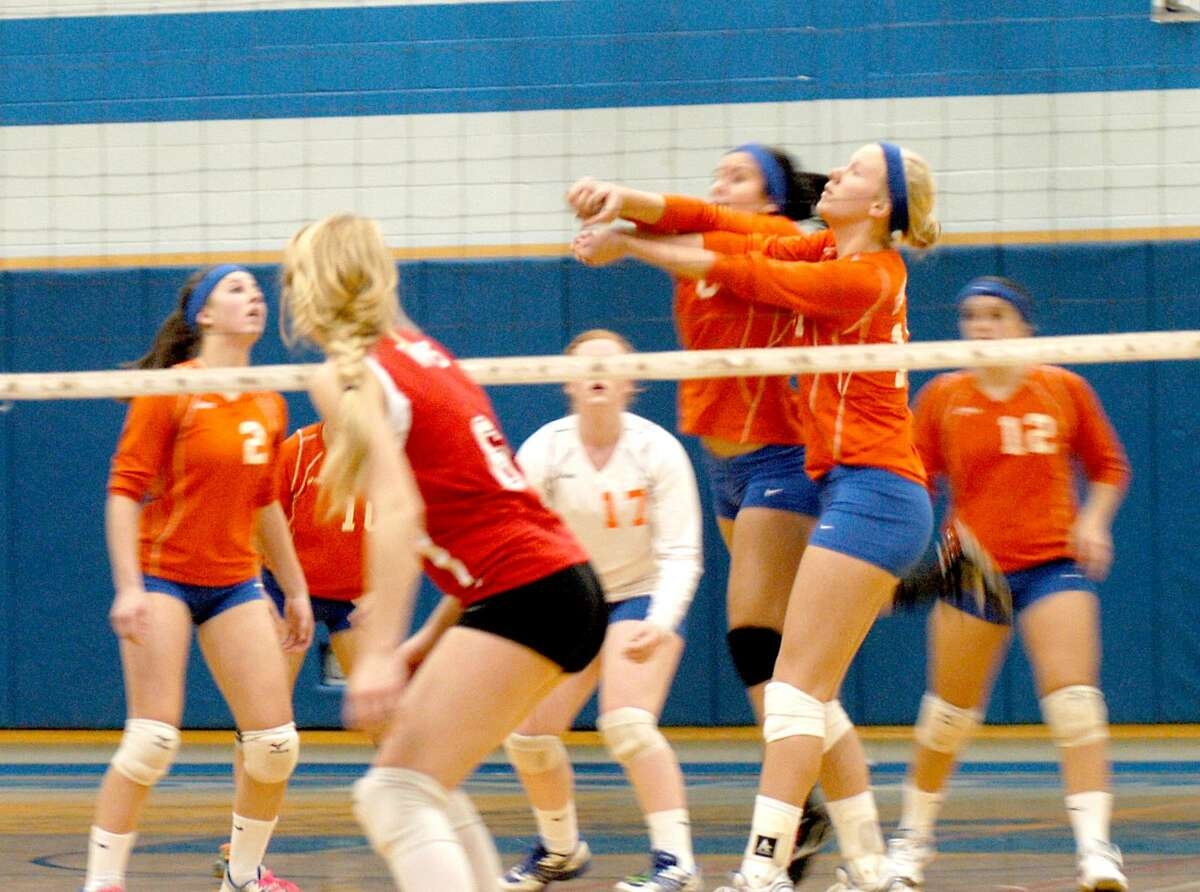 Dispatch Staff Photo by DAVID M. JOHNSON Oneida girls volleyball players set the ball in the second game of a match against rival VVS Monday in Oneida. The hosts won 25-19, 25-14, 25-20.