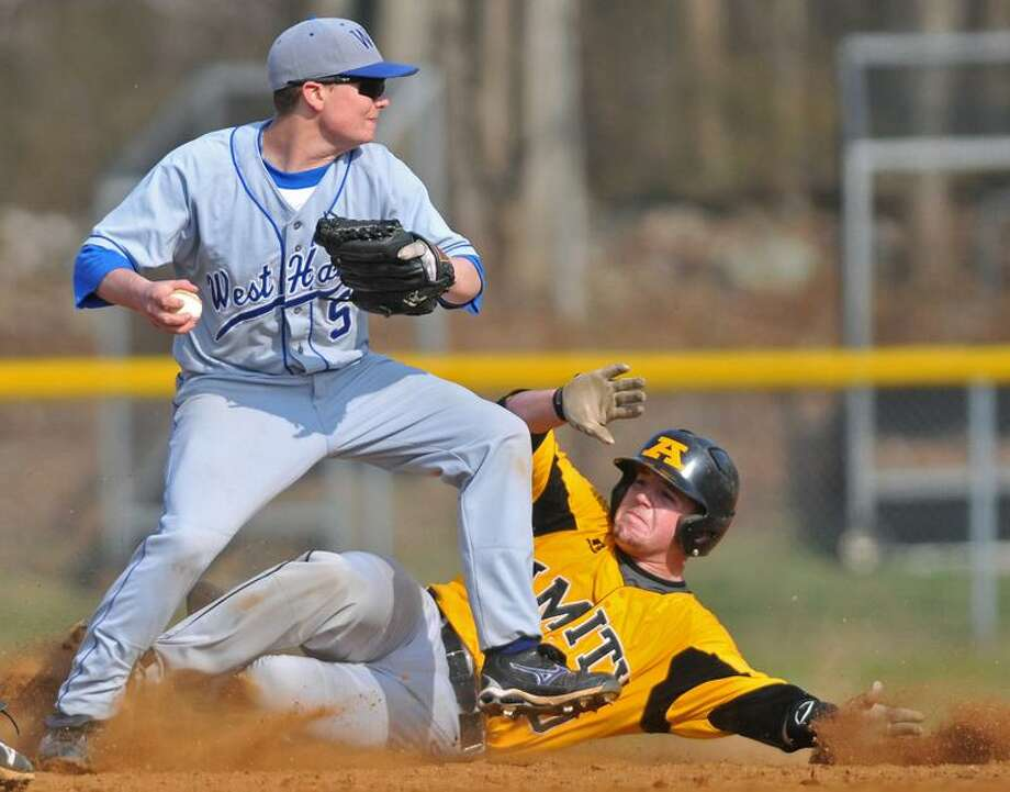 Woodbridge--Amity baserunner Paul Gusmano tries to break up a double play attempt by West Haven second baseman Alex Palmieri.  Photo by Brad Horrigan/New Haven Register-04.11.11.