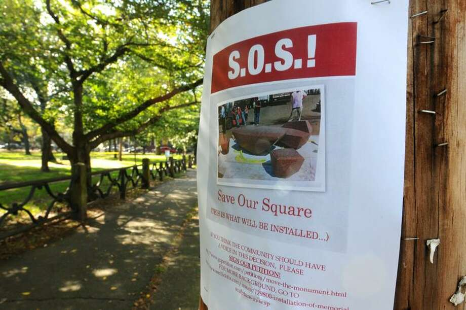 "A posted ""Save Our Square"" leaflet posted next to Wooster Square park on Greene Street near Wooster Place in New Haven calls for a petition protesting the installation of the ""DeLauro Family Table"" monument to be placed in the park. (Peter Hvizdak/Register) / PETER HVIZDAK"