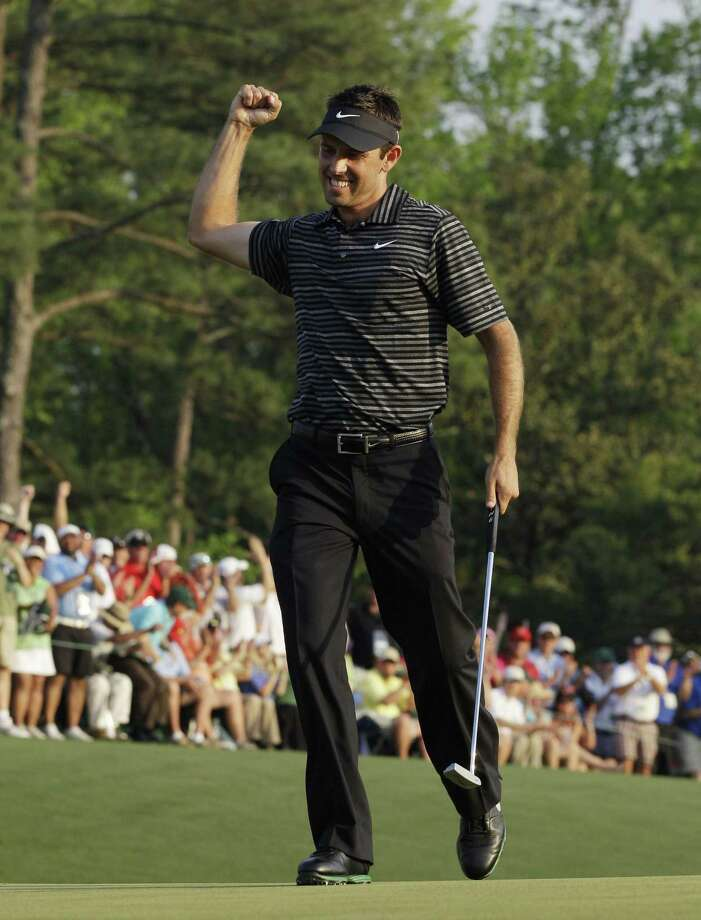 Charl Schwartzel of South Africa reacts after a birdie putt on the 18th hole during the final round of the Masters golf tournament Sunday, April 10, 2011, in Augusta, Ga.  (AP Photo/Chris O'Meara) Photo: ASSOCIATED PRESS / AP2011