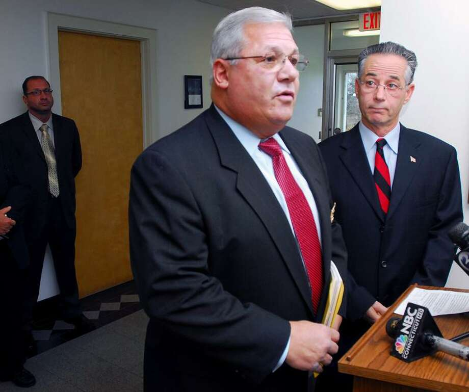 East Haven Police Chief Leonard Gallo, center, speaks to the press after being reinstated as chief Nov. 29 by East Haven Mayor Joe Maturo Jr., right. (Arnold Gold/Register)