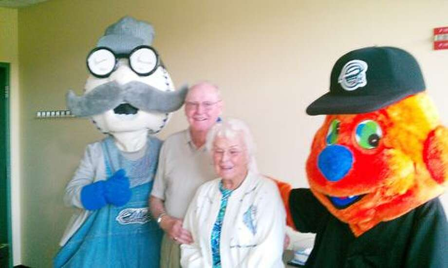SUBMITTED PHOTO Jack and Dorothy Stone pose with Syracuse Chief mascots Scooch and Pops.