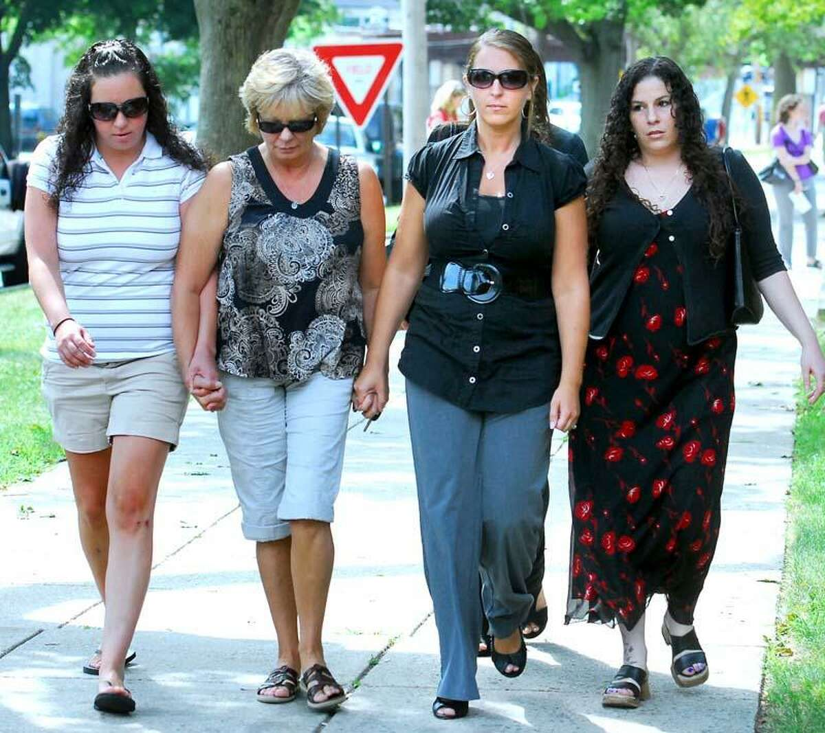 Deann Uberti (second from right) walks out of Superior Court in Milford on 8/5/2011 with family after John Billingslea pleaded guilty to the murder and rape of her daughter, Ariana Uberti, in 2009. Photo by Arnold Gold/New Haven Register
