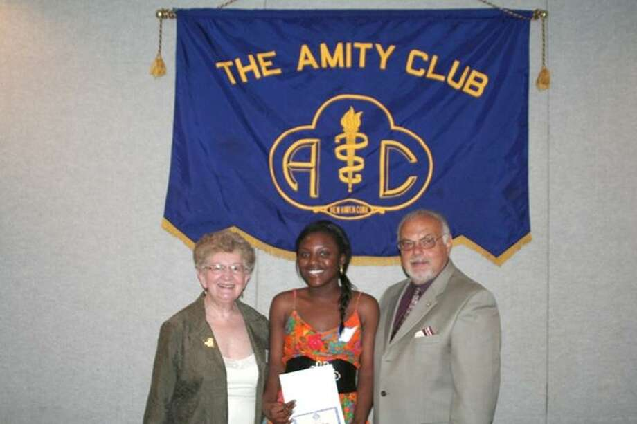 Tony Pinto/Amity Club: Receiving the DiMeola Family Award is Noumso Kaba, a West Haven High School senior. She's joined by Rita Landino of North Haven and Fred DiNapoli, Amity Club president.