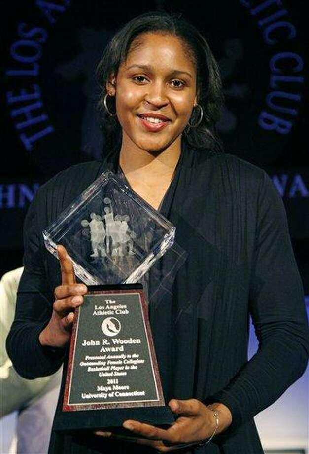 Maya Moore of the University of Connecticut poses with her trophy after winning the women's John Wooden Award during the award ceremony Friday, April 8, 2011, in Los Angeles. (AP Photo/Jason Redmond) Photo: AP / FR74394 AP