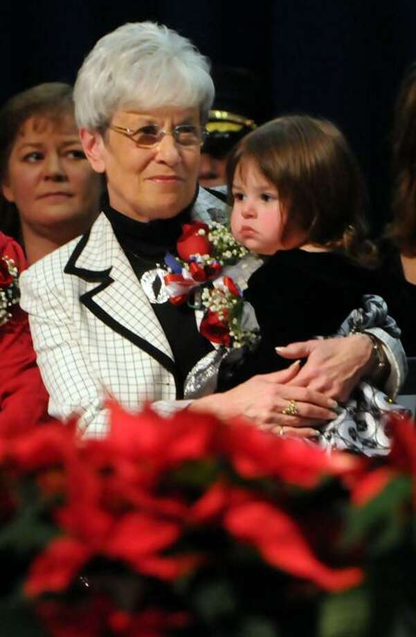 West Haven High School: Lt. Gov. Nancy Wyman holds Mayor John Picard of West Haven's daughter Alessandra age 23 months while Picard gives his inaugural speech. Photo by Mara Lavitt/New Haven Register12/4/11