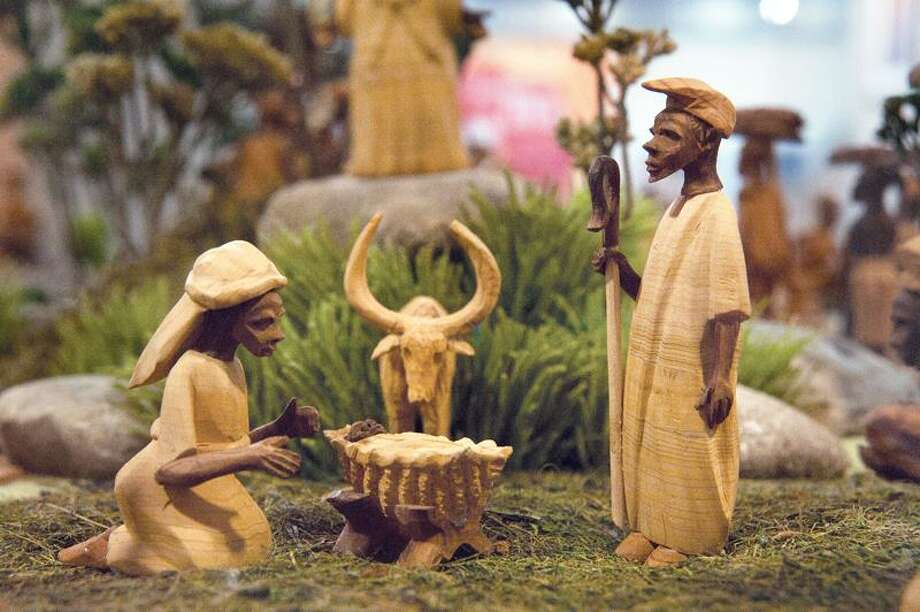 Native Village with Nativity Scene -Nigeria - wood, clay, plastic. Part of a Creche display at the Knights of Columbus Museum in New Haven 1.20.11 vmWilliamsplastic