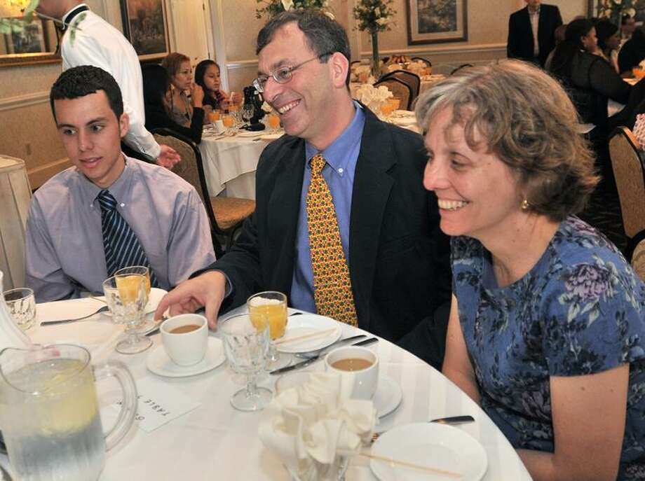 Wilbur Cross High School senior James Doss-Gollin, named one of the Register's Youths of the Year, attends a special breakfast for honorees at Amarante's Sea Cliff Saturday morning. With Doss-Gollin are his parents, Doug Gollin and Cheryl Doss. Brad Horrigan/Register