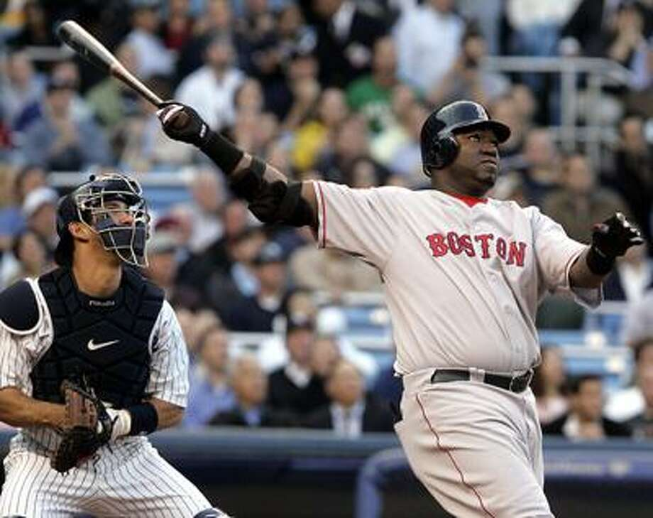 Boston Red Sox's David Ortiz follows through on a two-run home run during the first inning of baseball action against the New York Yankees at New York's Yankee Stadium Wednesday May 10, 2006.(AP Photo/Frank Franklin II) Photo: ASSOCIATED PRESS / AP2006