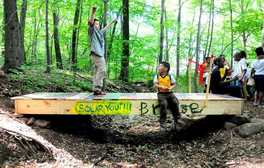 Julio Solivan, 9, left, and Ray Flores, 5, right, helped build at West Rock Ridge State Park in New Haven for the Solar Youth organization. Photo by Arnold Gold/Register