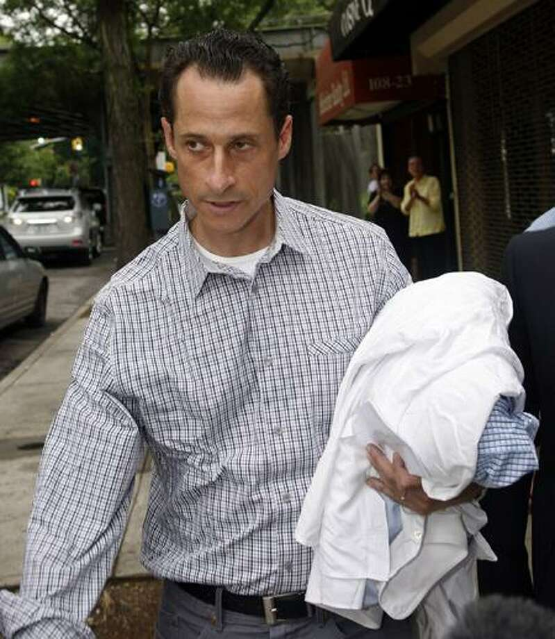 Rep. Anthony Weiner, D-N.Y., carries his laundry Saturday to a laundromat near his home in the Queens borough of New York City. Associated Press Photo: AP / AP2011