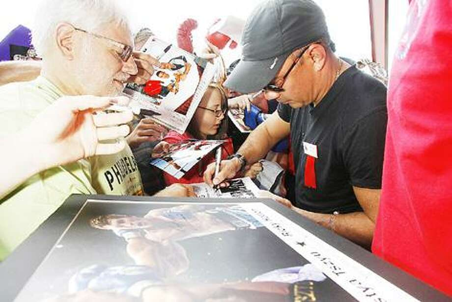 Photo by JOHN HAEGER International Boxing Hall of Fame 2011 member Kostya Tszyu signs autographs for fans at the hall on Friday, June 10, 2011.