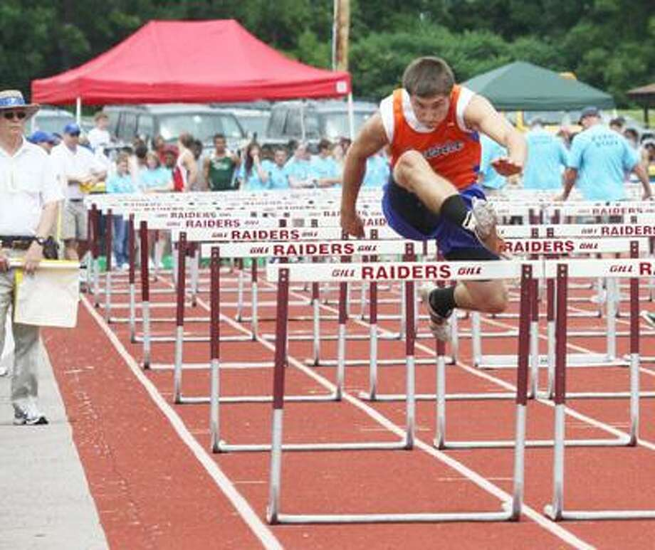Photo Special to the Dispatch by BRIAN HOREY Oneida competes in the hurdles at Friday's championship track meet.